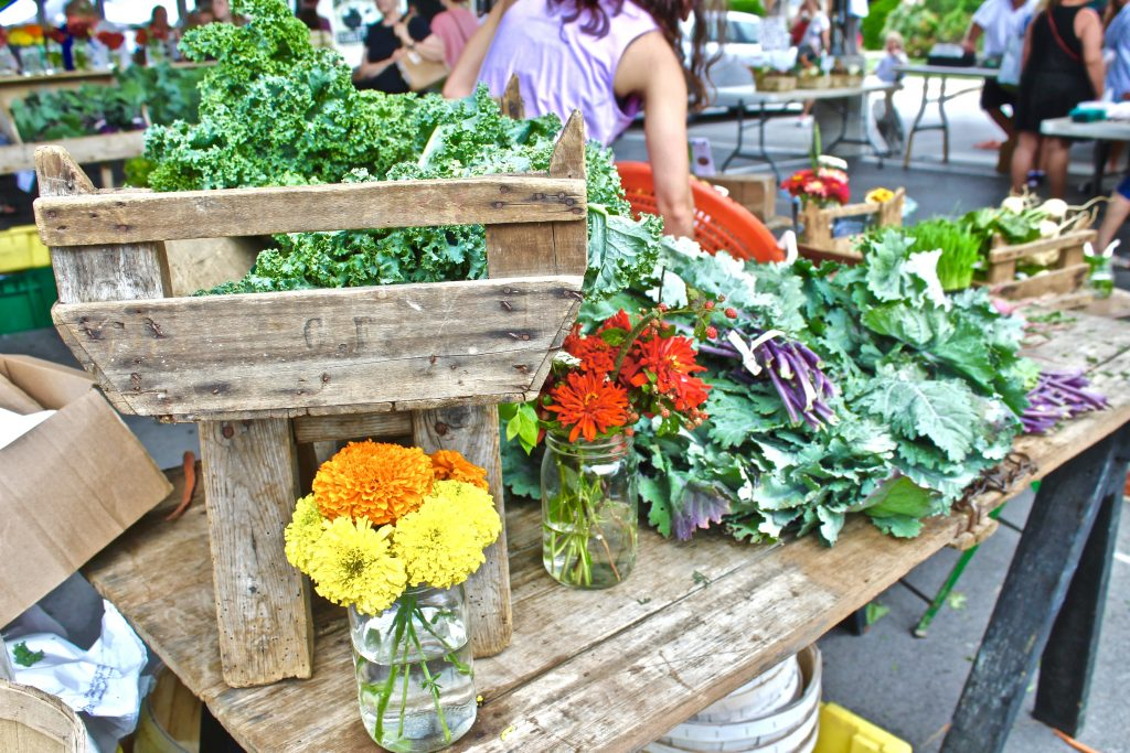Booth with flowers and greens at Franklin Farmers Market